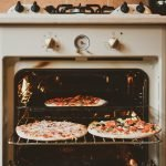 Getting-pizza-ready-in-a-retro-oven