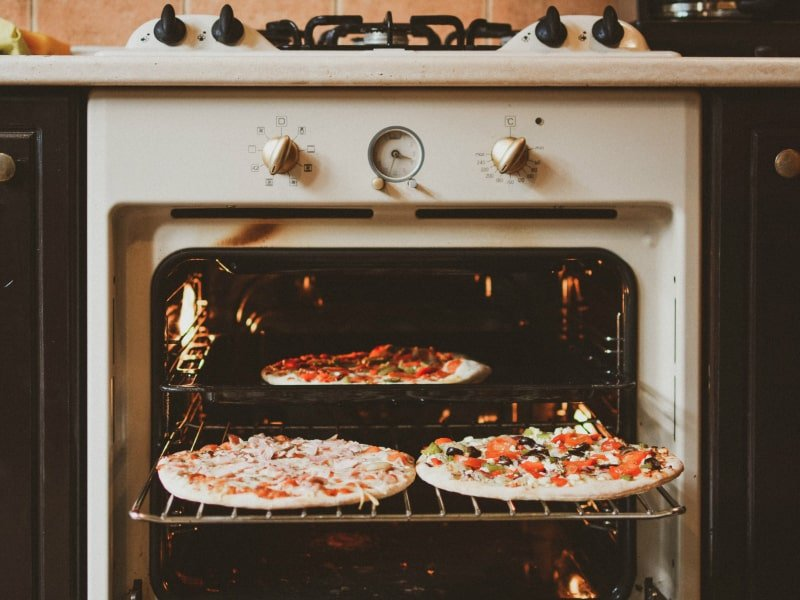 Getting-pizza-ready-in-a-retro-oven
