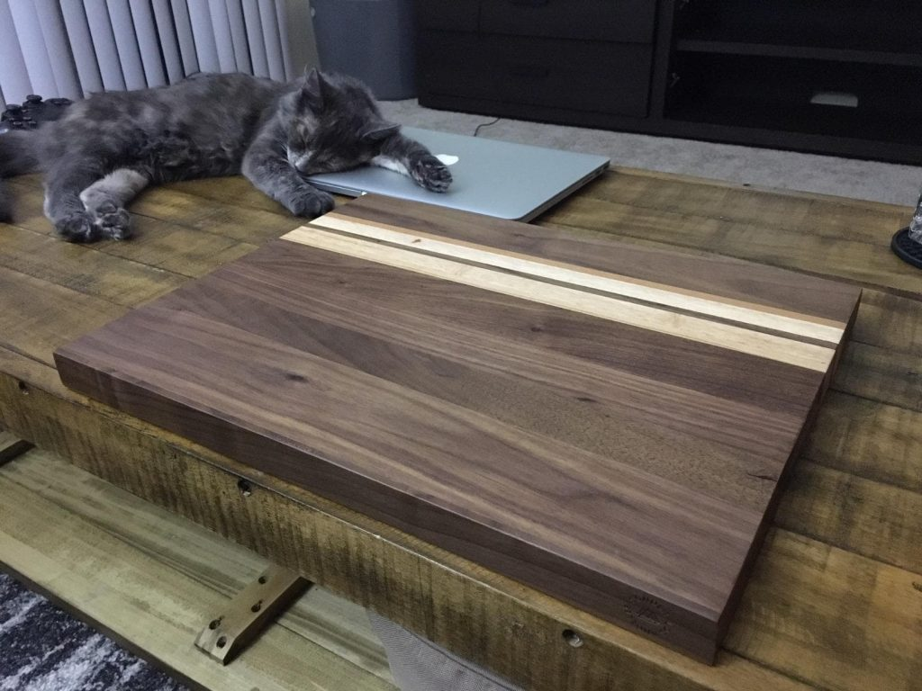 Large Multipurpose American Walnut Wood Cutting Board on table