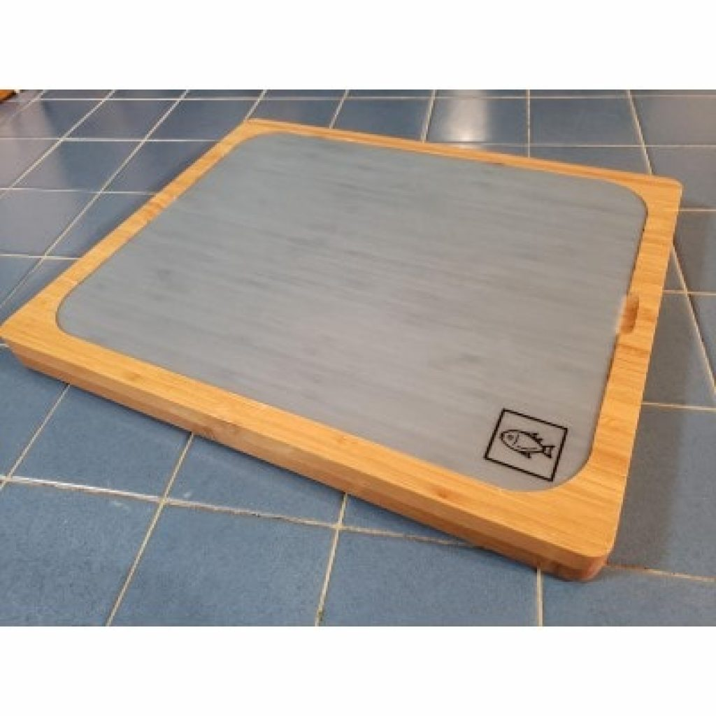 Seville Classics Easy-to-Clean Bamboo Cutting Board with fish mat on it
