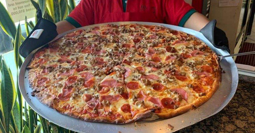 Big Pizza at man hands